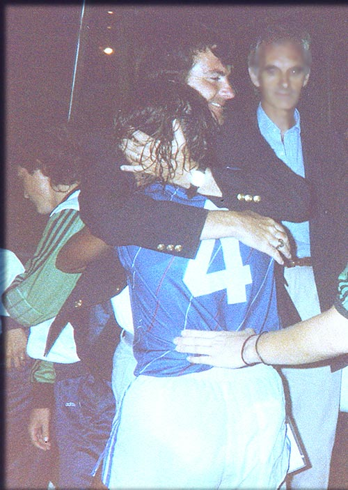 Emily Harner, being hugged by her college and National Team coach Anson Dorrance